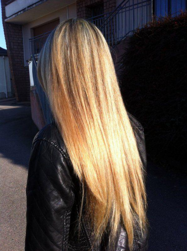Mèches blond très clair et cuivre pour un reflet vénitien