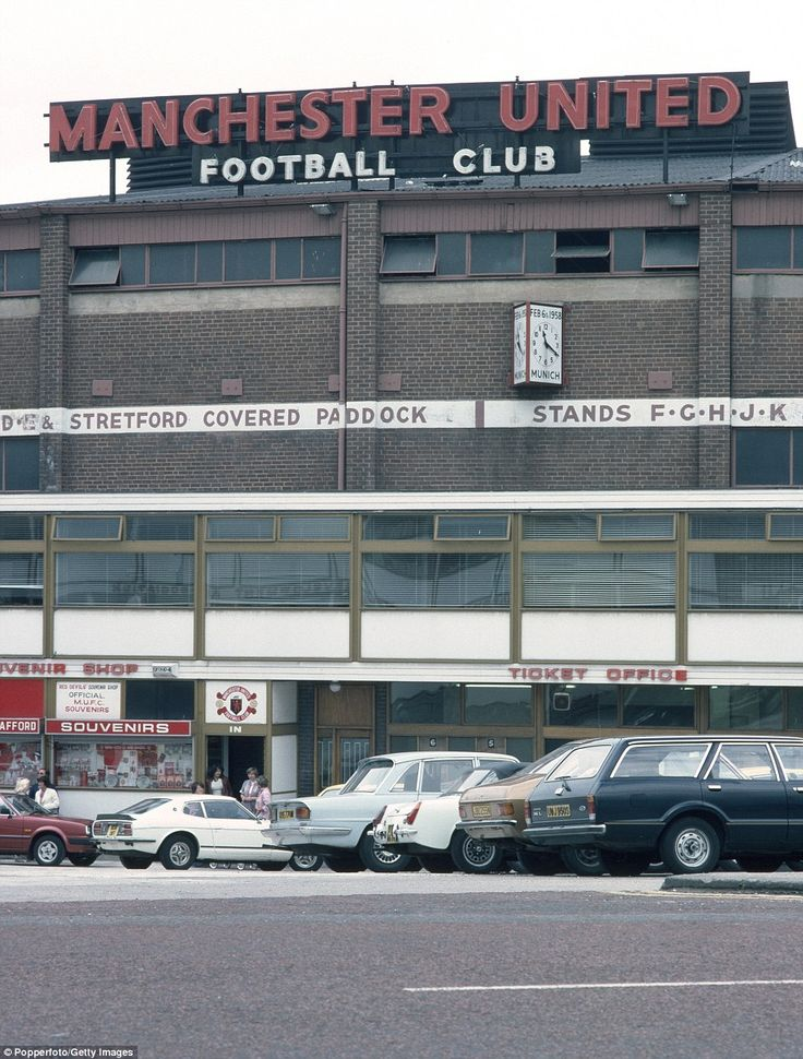 An exterior shot of Old Trafford in August 1979. A clock is mounted to the wall with the time and date to remember those who tragically died in the Munich Air disaster