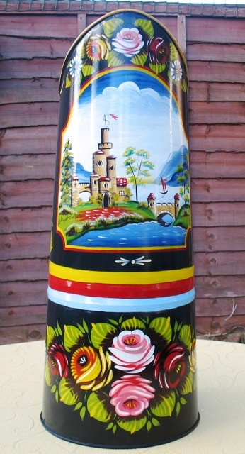 A full size galvanised steel coal hod, painted on a black background with roses and castles.