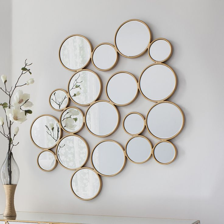 Modish Living's Golden Pebbles Wall Mirror is ideally suited to the living room.  It is a real statement piece with its multiple round mirrors and soft gold protruding frame.