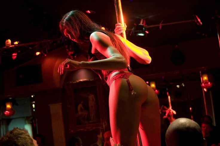 The Naked Eye  is a strip club front with an escort service run through the back...