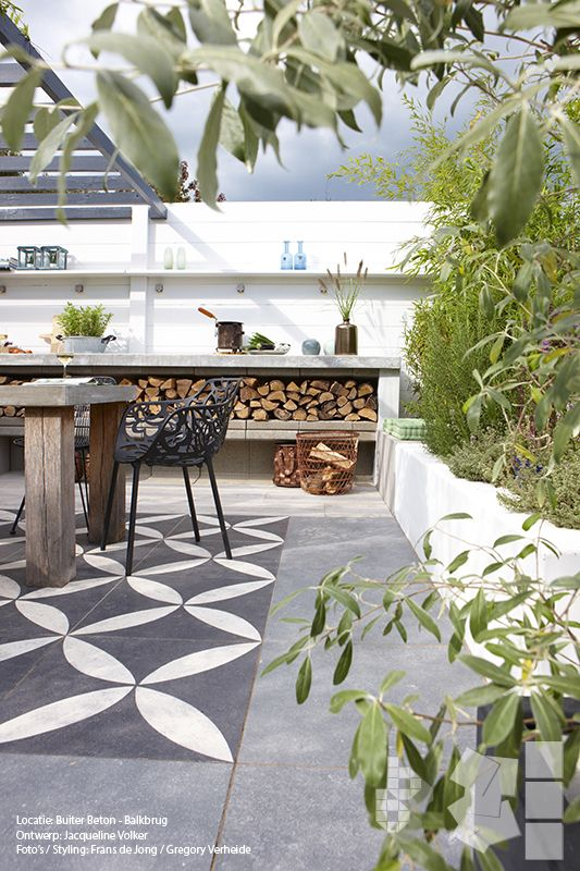 BBQ prep area, I like that it's a bench/prep area/storage for wood (looks really graphic & stylish), tile inlay in concrete, veggie & herb beds close at hand, #dining