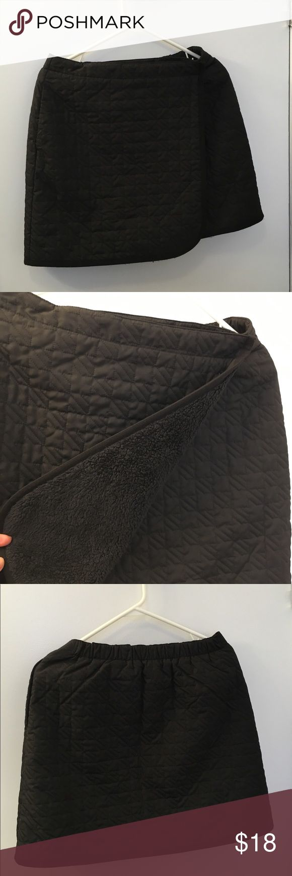 Uniqlo Skirt Warm Black Skirt Size S-M By Uniqlo made a quilted fabric woven, fleece interior lining with pockets. Fit perfectly s-m many button closure. 100%Polyester. Great Condition Uniqlo Skirts Midi