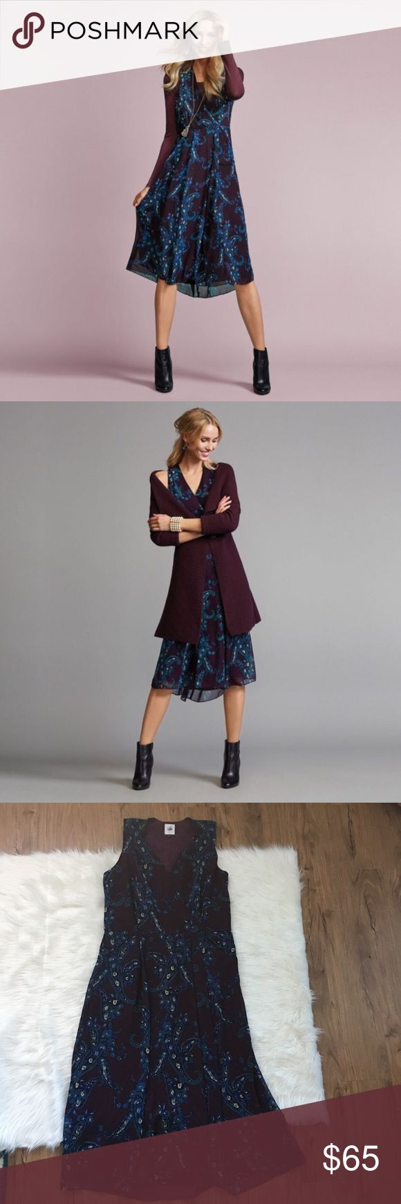 CAbi Fall 2017 Treasure Purple Blue Dress 3461 Tag has a cut as shown in photos. Inspired by a vintage '40s. True to size and fitted at the waist with a side zip, the deep V-neck elongates your frame, and the overlay is tacked down to stay put. Pockets (yes, pockets!) add a sense of whimsy while pleats offer a bit of volume, reinforcing the ethereal feel and flow of the fully-lined high-low hem.    Paisley floral pattern Midi length with high-low hem, side zip, empire waist, and pockets…