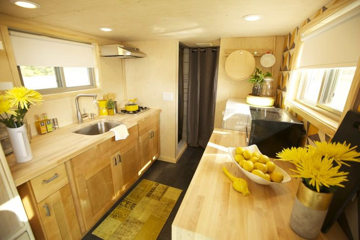 Wishbone Tiny Home Company of Asheville, NC - kitchen inside tiny home yellow accents on light unfinished wood