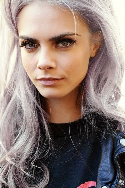 Cara Delevingne with lilac grey hair.