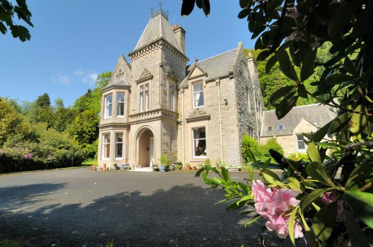 An impressive, detached Scots Renaissance style villa with an elevated setting overlooking the Scottish Border town of Hawick
