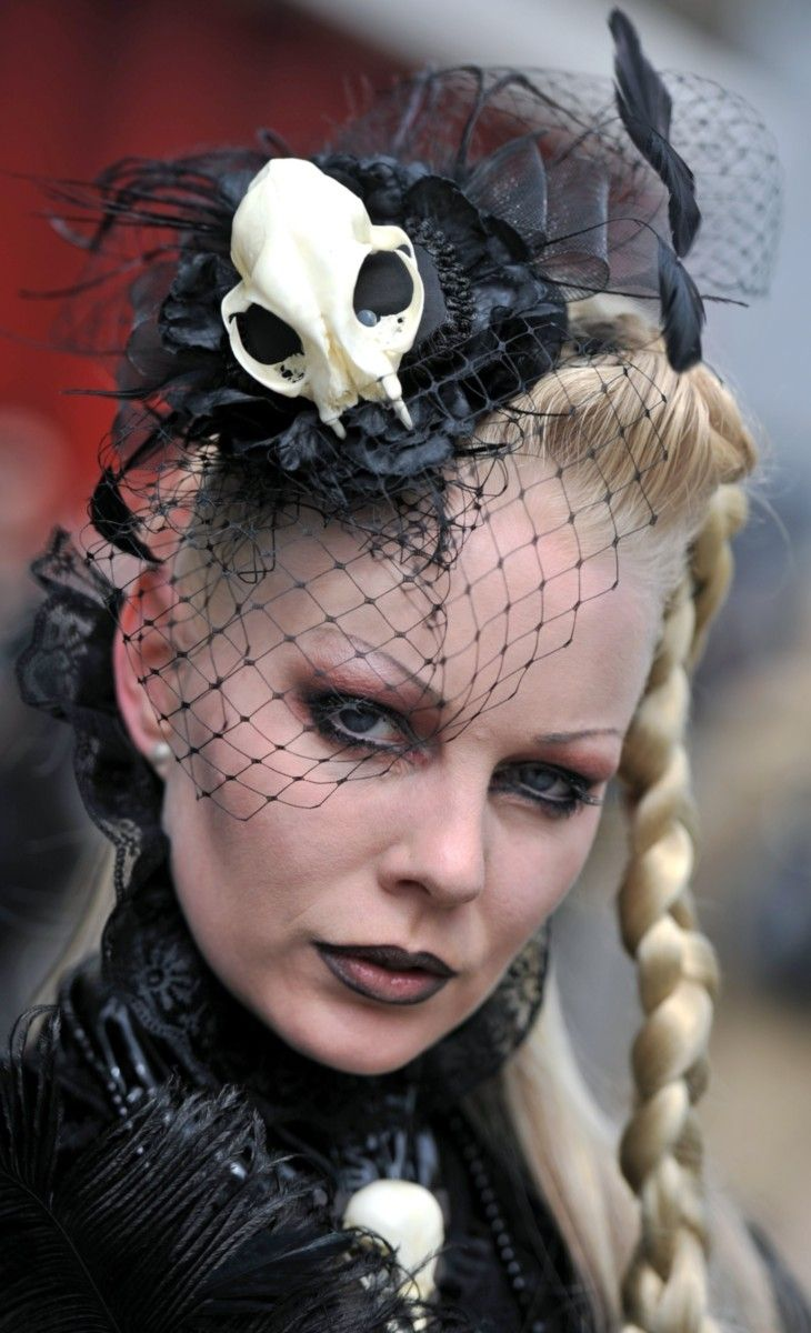 Dressed up people attend the so called Victorian Picnic during the Wave Gotik Treffen festival in Leipzig, Germany on May 13, 2016