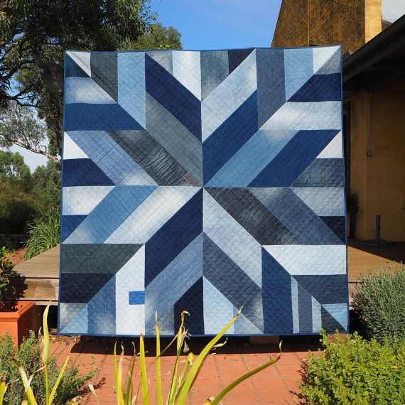 I love how the wear and tear from upcycled jeans adds texture and depth to this quilt.