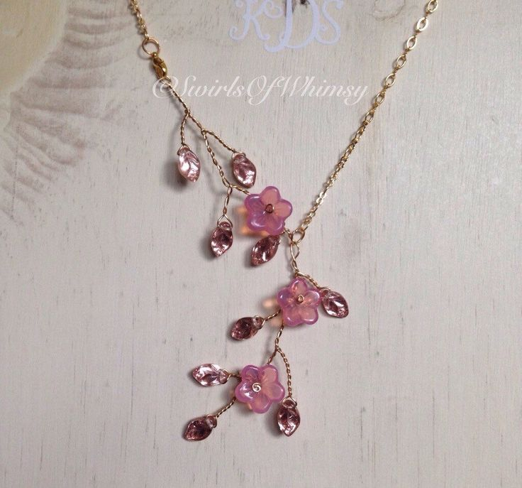 A personal favorite from my Etsy shop https://www.etsy.com/ca/listing/285486083/pink-gold-flower-necklace-brass-wire