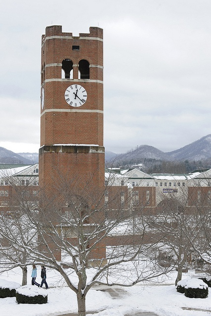 Snow blankets the UC lawn and mountains in the background.