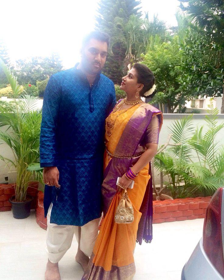 @ujjwala_n Traditional South Indian Couple.  Yellow purple Silk saree Smiling couple candid kanchivaram southindian hairstyle couple wedding bridal bride jewellery gold couple photoshoot dhoti sherwani dress.