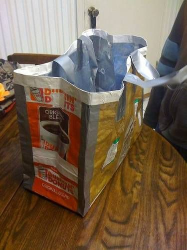 Upcycled coffee bags into a tote- but instead of using duct tape (unless you hate sewing) I'd rather stitch the edges together.