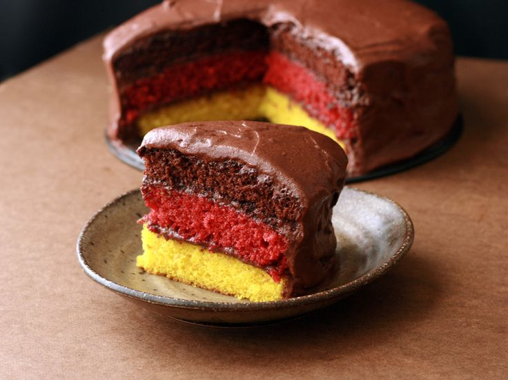 German Flag Layer Cake Bring Oktoberfest to a sweet end with this yellow, red velvet, and chocolate cake!