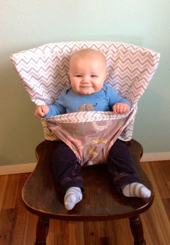 Seems useful.  The Portable Anywhere Highchair - Custom - Reversible Fabric High Chair