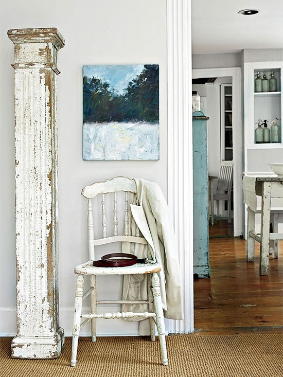 Chippy column and white chair