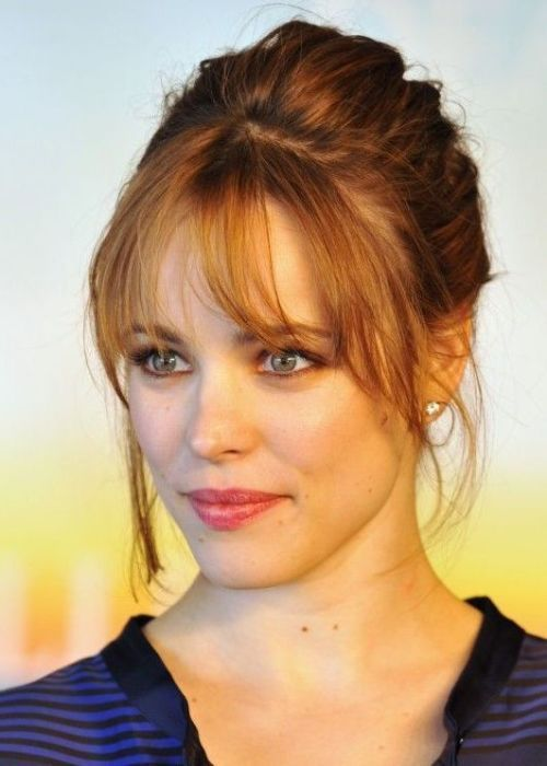 30 Best Hairstyles for Big Foreheads | herinterest.comCanadian actress Rachel McAdams looks gorgeous with her simple up'do and soft, wispy bangs. We love how her bangs have been tapered and rounded so that they are longer at the sides, framing her face perfectly. Wispy bangs cover your forehead whilst still looking light and soft, instead of thick and bulky bangs that can look too harsh. For an extra-romantic finishing touch, embrace your hair's natural texture and let the flyaway hairs…