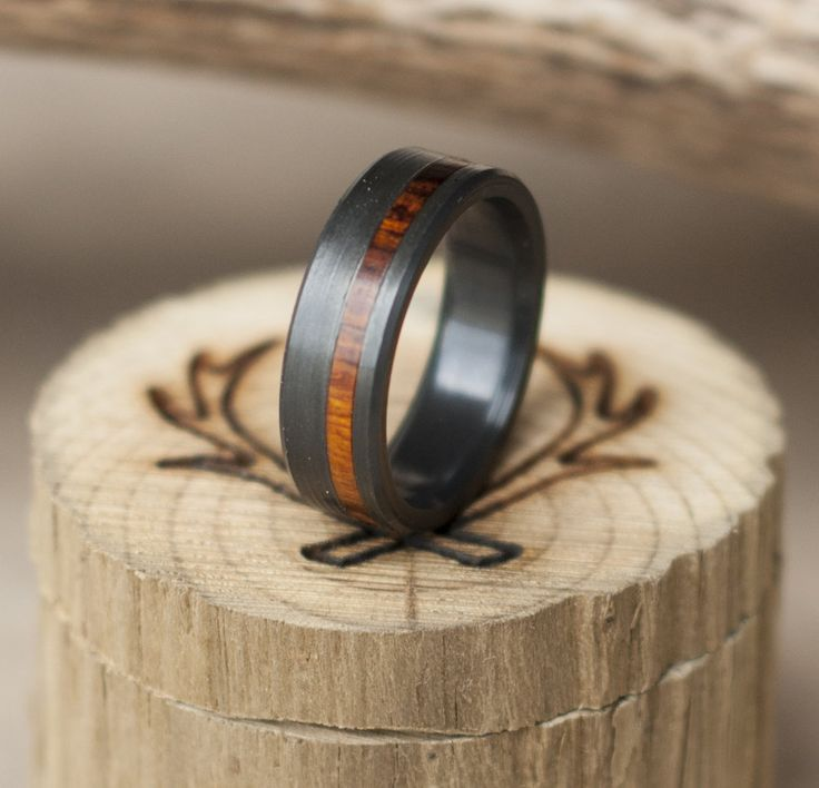 Each or our rings is a handcrafted one of a kind piece, and is made to order for you and your significant other by a passionate and skilled artisan. This ring features fire-treated black zirconium with an ironwood inlay. Other wood & inlay options available upon request. Available in: T