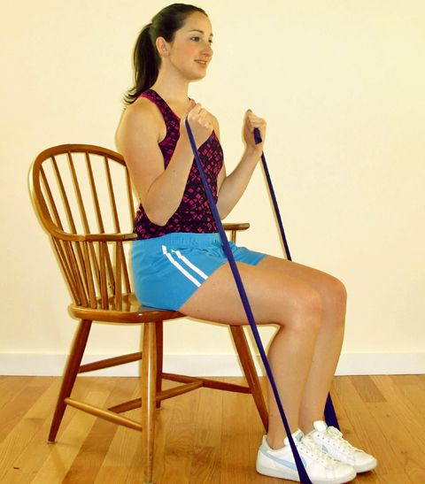 bicep curls resistance band workout at work girl doing arm exercises in a chair sit down workout weights exercise fitness