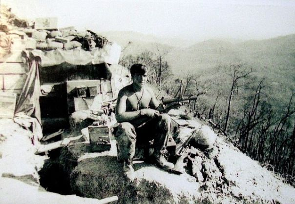 """Pfc. Dale Tauer, a member of the 101st Airborne, holds an M-79 Grenade Launcher as he sits atop a hill in Vietnam. It was just before """"The Battle of Ripcord,"""" one of the largest battlers of the war, that soured the American public on Vietnam. July 1970. ~ Vietnam War"""