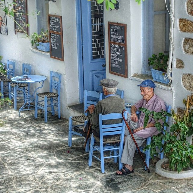Pappous at little corner cafe in Folegandros Island, Greece