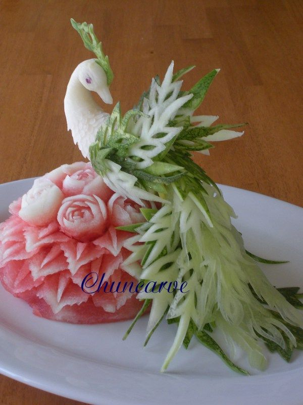 Food Carvings Peacocks | This lovely peacock carve from daikon radish and watermelon peel for ...