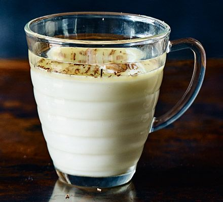 Ever tried a boozy hot chocolate? Whip up this blend of white chocolate, coconut rum and fresh coconut flakes and you may never look back...