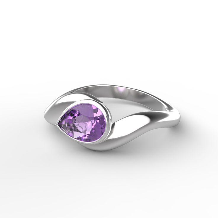 La bague Lily est formée d'un jonc courbé serti d'une pierre en forme de poire. Sa douce cambrure en fait une bague à l'aspect vintage qui met en valeur la beauté de sa pierre en « goutte ». Elle valorisera une tenue de soirée et la rehaussant d'un bijou sophistiqué.   Faites-en votre bijou personnalisé en choisissant votre métal et votre pierre préférés.