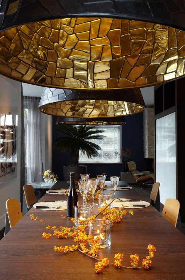 Black outer and gold internal large pendants over dining table.    The Design Work of Studio Osiris Hertman