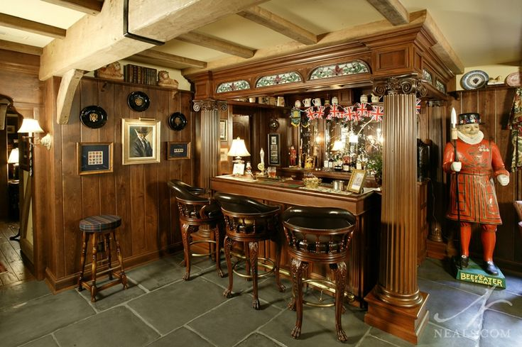 "A homeowner had a collection of artifacts from England and transformed a basement into a replica of an English pub complete with a ""Beefeater"" and Union Jack décor. Description from info.neals.com. I searched for this on bing.com/images"