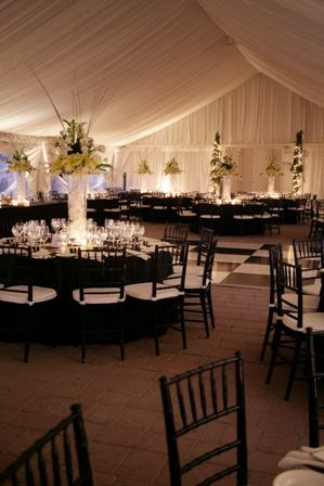 Loving the black linens, white napkins, black Chiavari chairs, with white padded seats. The whole room screams elegance! Very classy. The dance floor, I would have love to see all black with a white border...