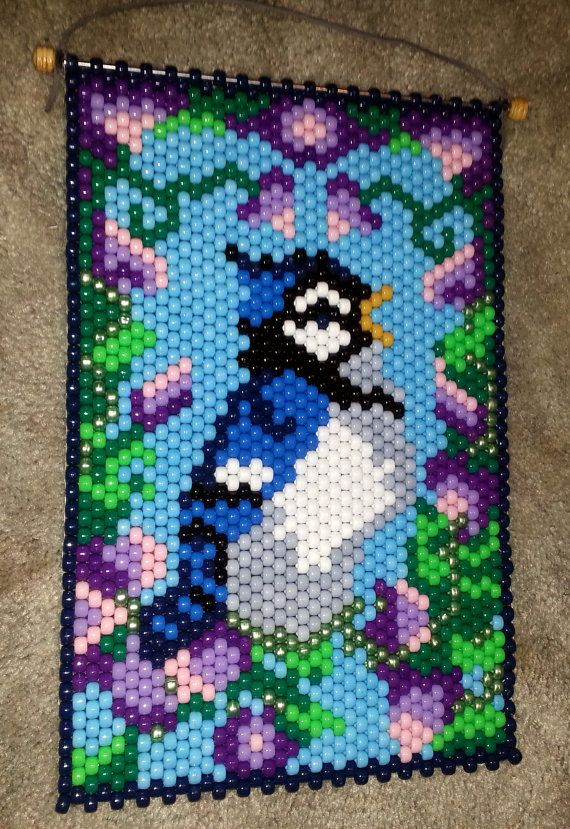 Blue Jay Beaded Banner is approx. 15 X 10. A must have for all bird lovers. Looks great as a wall hanging, door hanger, or window hanger. Image can be seen from either side and therefore can be hung in either direction.