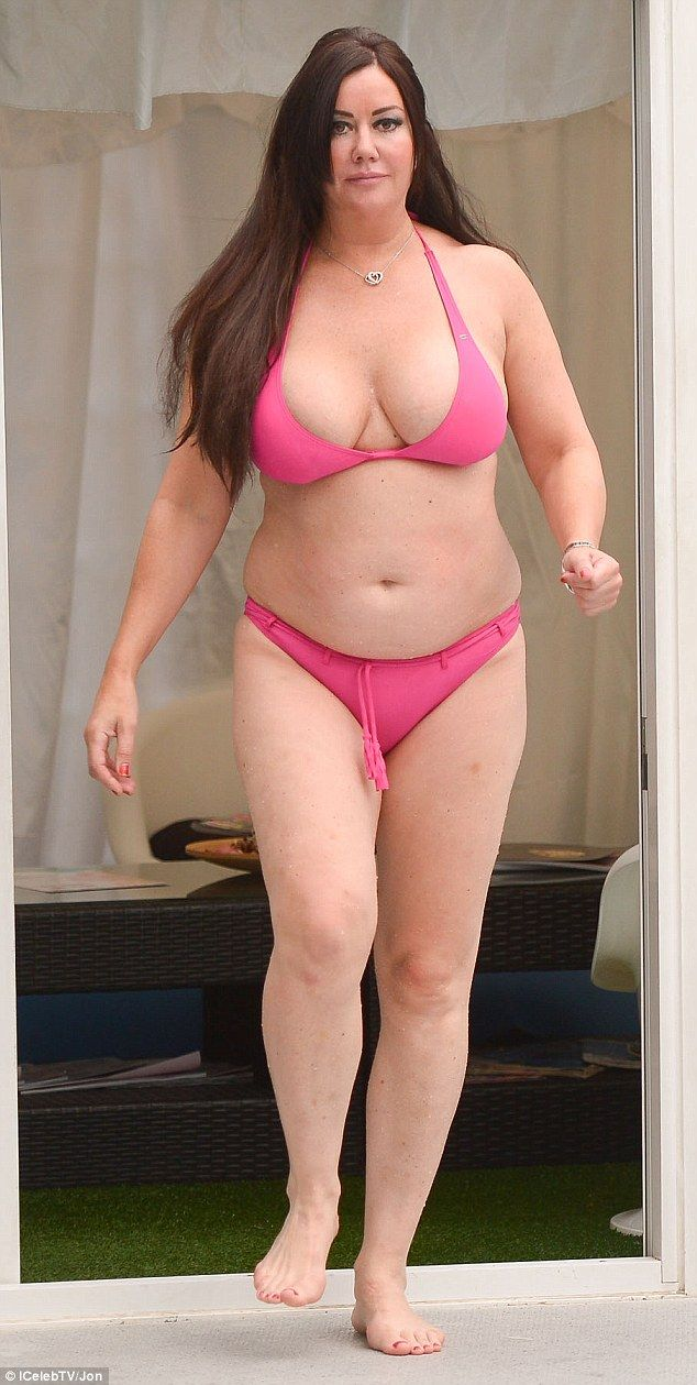 Barely-there bikini: Ensuring that she flashed a serious amount of flesh, Lisa opted for a halter-neck bikini top, which barely succeeded in containing her ample cleavage