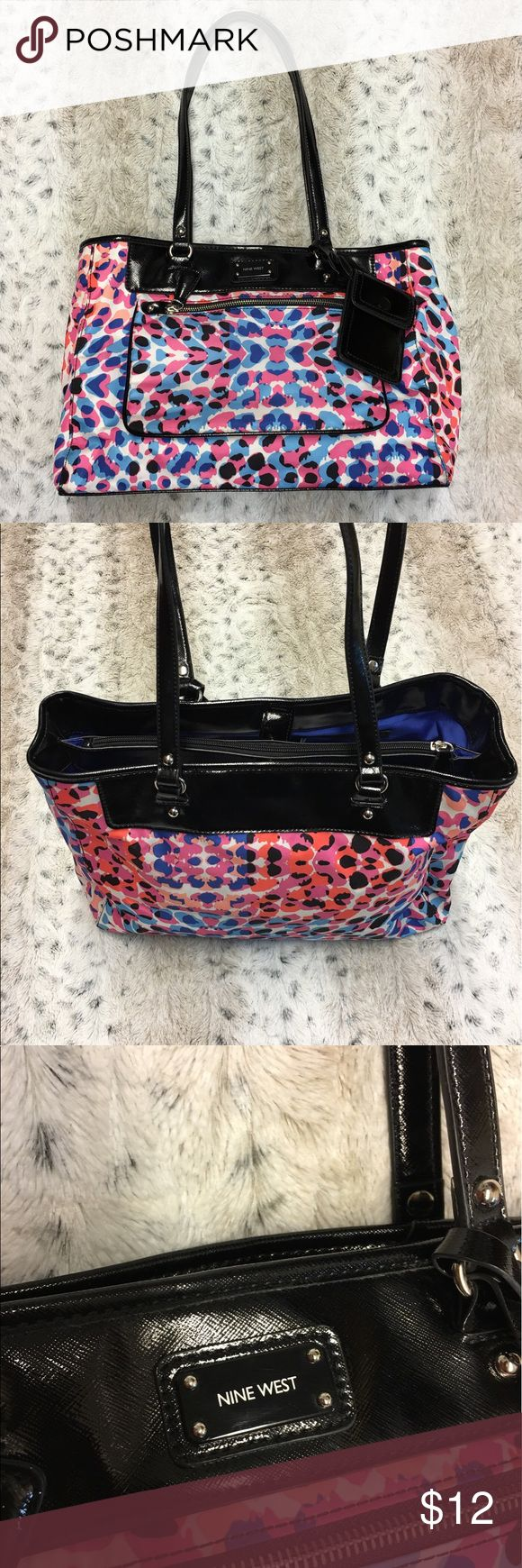 Nine West Purse Colorful Leopard Print Nine West Purse. In Good Condition, has a stain on the inside of Purse as shown in the 5th Picture, also a few spots in the 6th and 7th pic. Colors Pink, Hot Peach, Dark Blue, Light Blue and Black on a White Background Nine West Bags Shoulder Bags