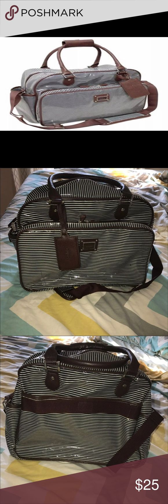 Guess Striped diaper bag Striped Guess Diaper Bag in great condition Bought from another Mercari seller, however I was gifted another diaper bag that we've began to use.  Has few stains on the inside  Originally priced $99.99 Guess brand  Insulated pockets to keep your baby's milk/food warm or cool Bags