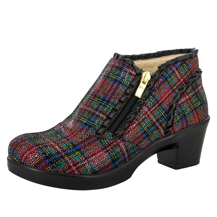 Ankle bootie style featuring printed Tartan leather and feminine ruffled leather edges. Features a zipper for easy on and off. Leather covered insole allo