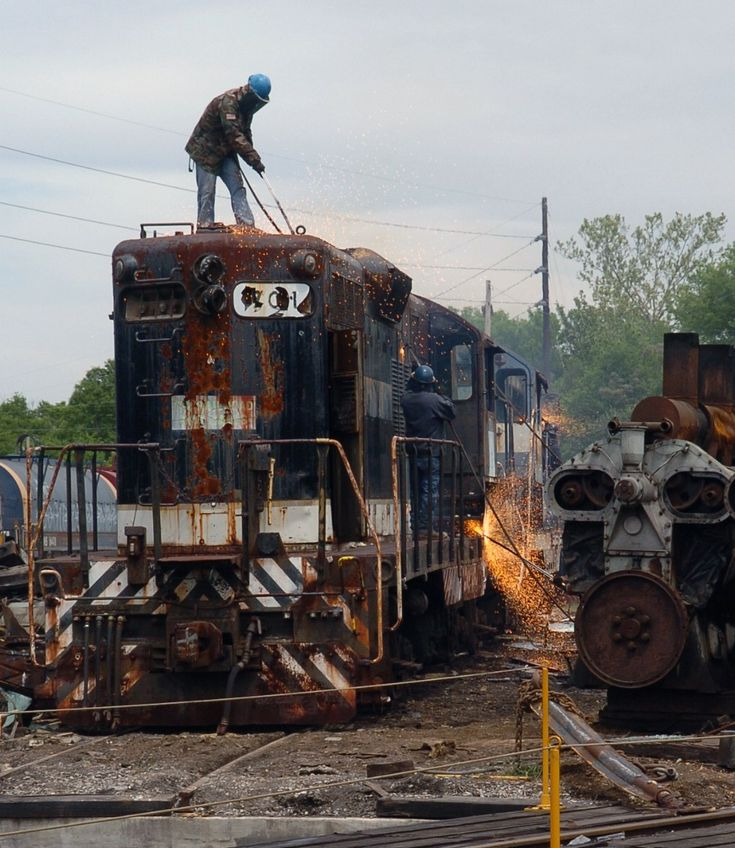 A firey death Description: Workers quickly get to work cutting up the CAGY 701 after