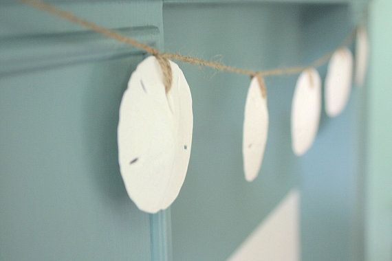 Love this idea from The Shabby Chic Cottage!  Sand dollars on jute twine.
