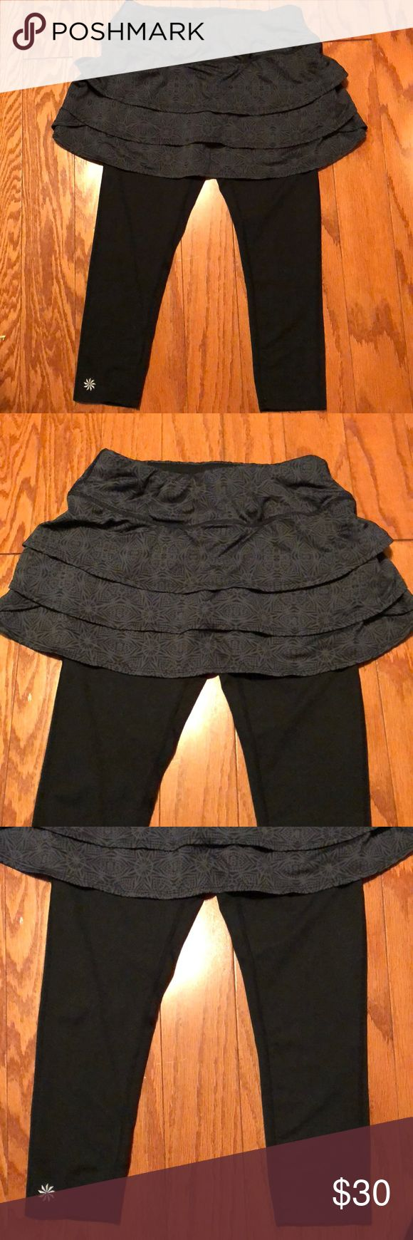SALE!!🎉 ATHLETA BLACK SKIRT WITH CAPRI LEGGINGS •Black Skirt with Capri Leggings •Stretchable •1 Back Pocket •Adjustable Pink String •Inseam: 18.5 •Waist Rise: 7.5 •Waist Line: 12 •Top to Bottom of Skirt: 11 •Top to Bottom (Whole): 25 •Material: see the last picture •In good condition Athleta Pants Leggings