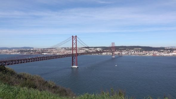 Panoramic View On The 25 De Abril Bridge In Lisbon by Discovod Panoramic View on the 25 de Abril Bridge in Lisbon, Portugal