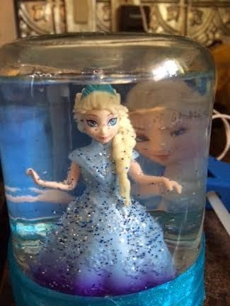 How to make your own Disney's Frozen Snowglobe!  This is awesome! My daughter loves it!