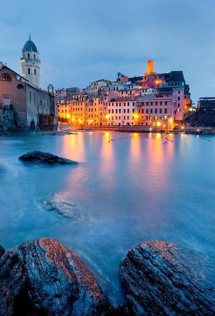 """Vernazza is a town and comune located in the province of La Spezia, Liguria, northwestern Italy. It is one of the five towns that make up the Cinque Terre region. Vernazza is the fourth town heading north, has no car traffic and remains one of the truest """"fishing villages"""" on the Italian Riviera."""