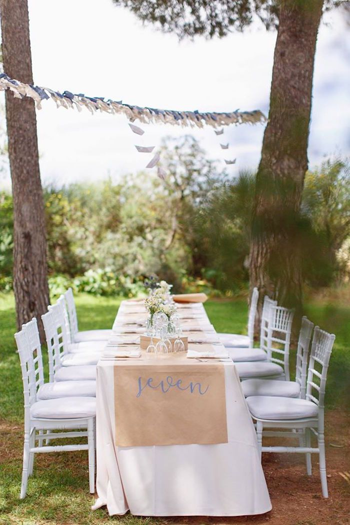 """""""Seven"""" tablerunner with chiavari chairs in gorgeous outdoor setting from a Vintage Travel Party at Kara's Party Ideas. See all the details and pics at karaspartyideas.com!"""