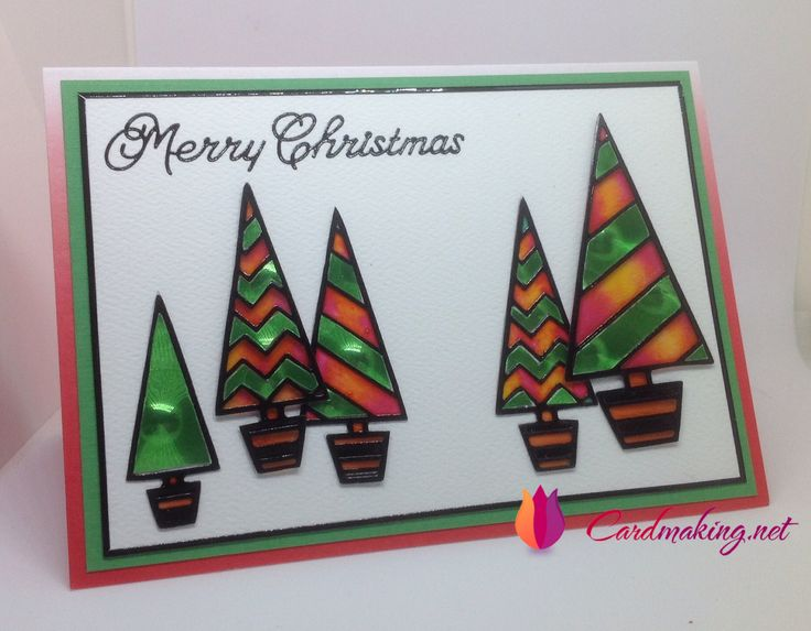Black Christmas tree peel off sticker on Acetate coloured with Glaze pens  plus Inlayed with Holographic Paper.