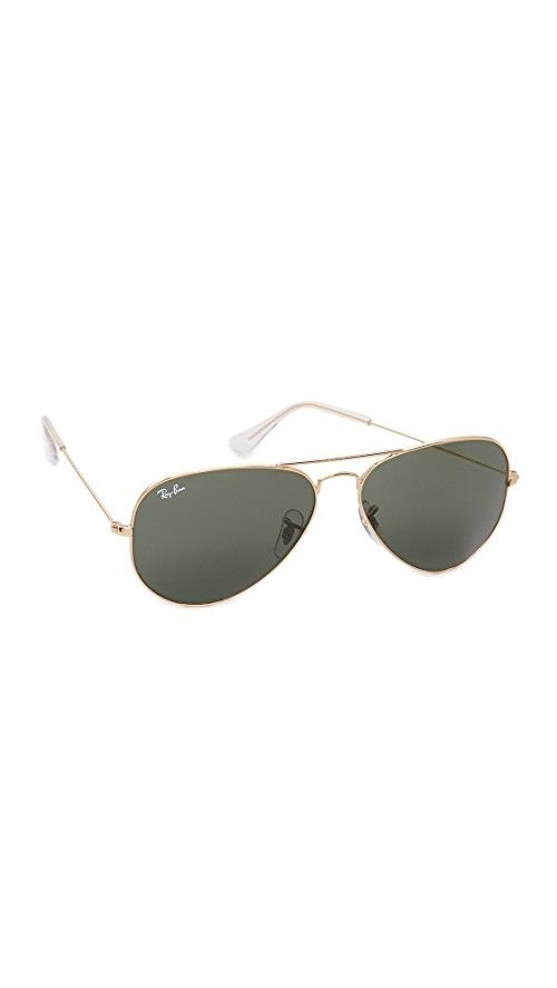 Ray-Ban Original Aviator Sunglasses | These Ray-Ban aviator sunglasses feature durable metal frames and logo lettering at the right lens. 100% UV protection. Case and cleaning cloth included. Aviator frame. Non-polarized lenses. Made in Italy. Measurements |  Width: 5in / 13cm Height: 1.75in / 4.5cm Lens Width: 58mm