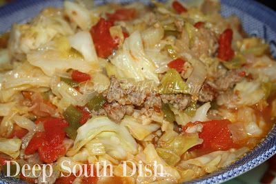 Smothered Cabbage with Tomato.  Chopped cabbage, smothered down with the trinity of vegetables, ground sausage and tomatoes.