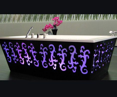 Luxury Backlit Bathtub- The new bathroom of GHG is the brainchild of design duo Catherine and Bruno Lefebvre. The border between the Baroque and the modern, luxurious bath combines beautiful aesthetics, ergonomics and technology in one. The thick black bath has a distinctive square shape, decorated with artistic cut outs, background lighting in a variety of colors