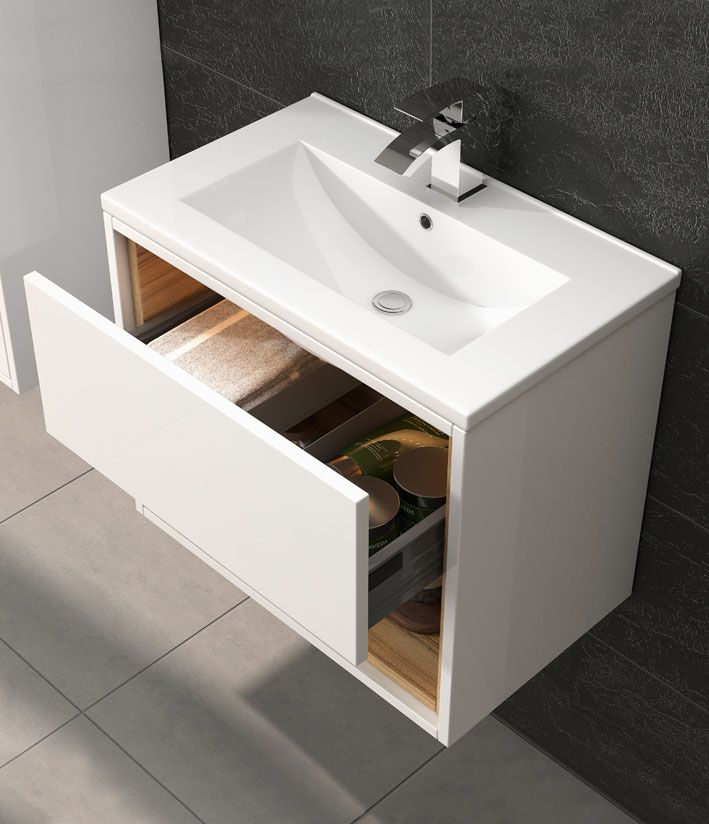 The touch technology of Coast furniture in conjunction with the low profile basin design establishes a unique look in the bathroom. The white and coco bolo colours contrast with darker tiles here to make a stunning statement.