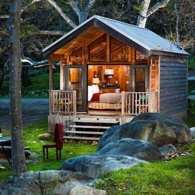 Tiny Cabin. This cozy cabin takes advantage of its scenic location with glass doors and a wall of windows, but maintains privacy by keeping the remaining walls window-free. An ample overhang lets you sit on the porch and enjoy the view outdoors even when it's raining.