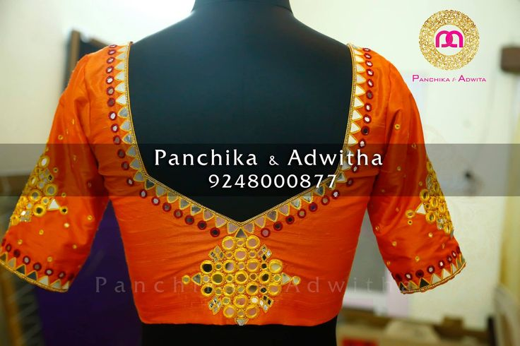 Blouse back with mirror work looking good. 04 October 2016